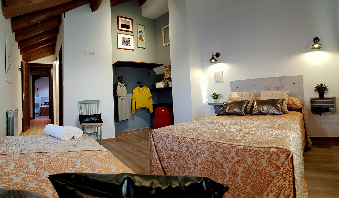Dormitorio Triple y Baño